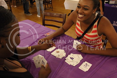 Emma Owens (left), senior in family studies, plays a card game with her roommate Kayla Green (right), senior in social work, at the BSU back to school BBQ in the Student Union Ballroom on August 27, 2016. (Miranda Snyder | The Collegian)