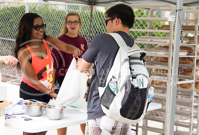 Sierra M, freshman in bakery science, assists a customer at the Bakery Science Club's bake sale that was held outside Shellenberger Hall on Sept. 21. 2016. (Anna Spexarth | The Collegian)