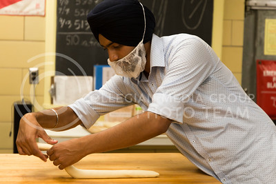Gagan Preet Singh, senior in bakery science, prepares bread dough to be baked in Shellenberger Hall  for the Bakery Science Club's bake sale that was held on Sept. 21, 2016. (Anna Spexarth | The Collegian)