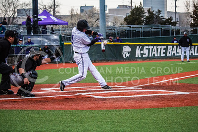 Senior, Jake Wodtke, makes contact with a pitch on Wednesday evening against University of Nebraska-Omaha. The Wildcats lost 5-2. (Logan Wassall | The Collegian)