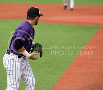 Senior first baseman, Jake Scudder, throws the ball during the K-State game against TCU at Tointon Stadium on Apr. 1 2017. (Sabrina Cline | The Collegian)