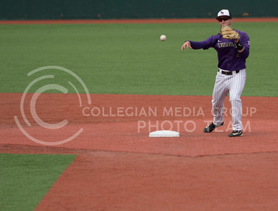 Senior second baseman, Jake Wodtke, throws the ball to first base during the K-State game against TCU at Tointon Stadium on Apr. 1 2017. (Sabrina Cline | The Collegian)