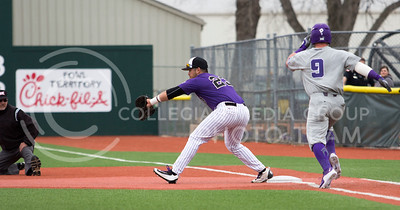 Senior first baseman, Jake Scudder, catches the ball for the out during the K-State game against TCU at Tointon Stadium on Apr. 1 2017. (Sabrina Cline | The Collegian)