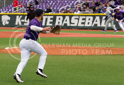Senior third baseman, Josh Ethier, fields and throws the ball to first base during the K-State game against TCU at Tointon Stadium on Apr. 1 2017. (Sabrina Cline | The Collegian)