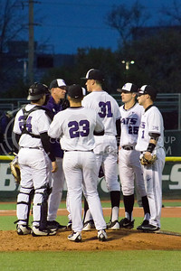 The team huddles during the game against TCU at Tointon Family Stadium on March 31, 2017. (Maddie Domnick | The Collegian)