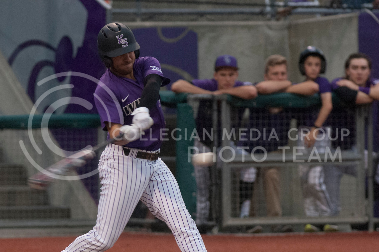 Members of the Kansas State University Wildcats baseball team play against the Texas Tech Red Raiders at the Tointon Family Stadium in Manhattan, Kansas on April 13, 2017. The Wildcats went on to win the game with a final score of 5-3. (Justin Wright | The Collegian)