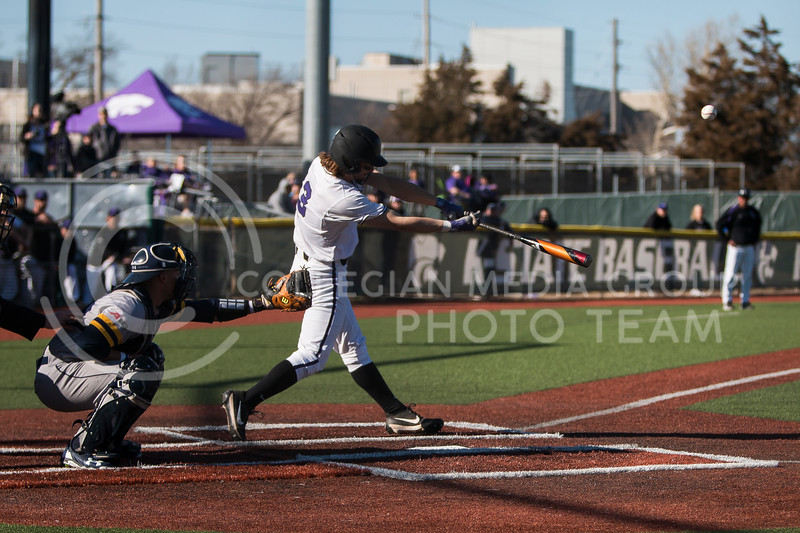 Sophomore outfielder, Cameron Thompson, swings at a pitch while at bat during the baseball game against La Salle in Tointon Family Stadium on Mar. 2, 2018. The Wildcats defeated the Explorers 9-3. (Logan Wassall | Collegian Media Group)