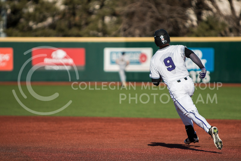 Senior first baseman, Trent McMaster, rounds first towards second during the baseball game against La Salle in Tointon Family Stadium on Mar. 2, 2018. The Wildcats defeated the Explorers 9-3. (Logan Wassall | Collegian Media Group)