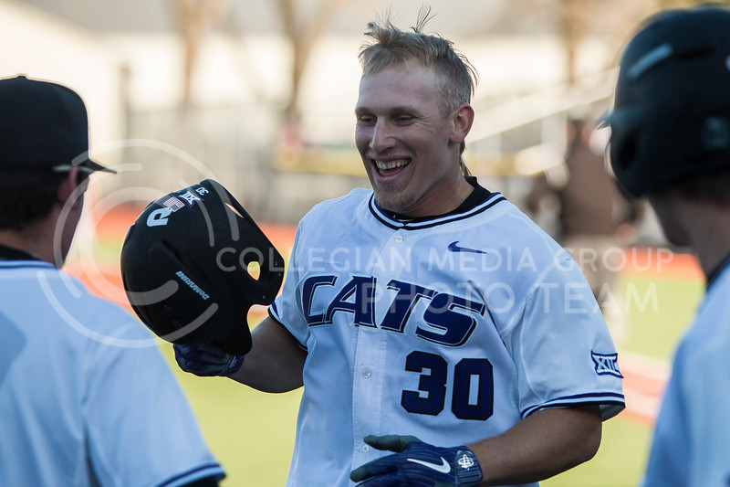 Junior ourfielder, Drew Mount, celebrates with his teammates after hitting a home run during the baseball game against La Salle in Tointon Family Stadium on Mar. 2, 2018. The Wildcats defeated the Explorers 9-3. (Logan Wassall | Collegian Media Group)