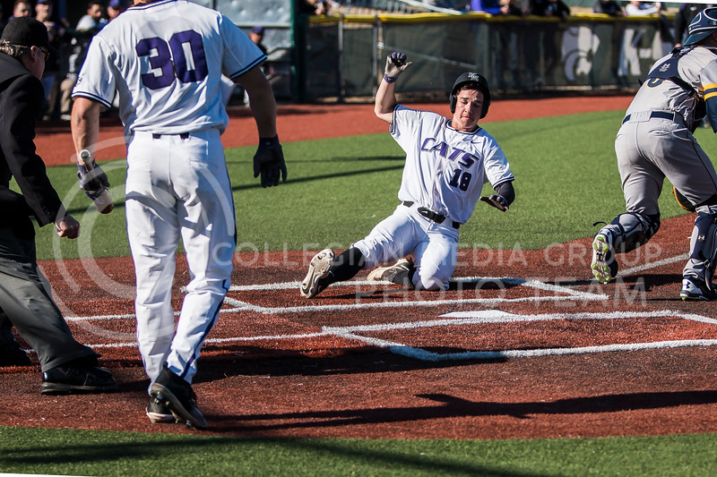 Sophomore outfielder, Will Brennan, slides into home during the baseball game against La Salle in Tointon Family Stadium on Mar. 2, 2018. The Wildcats defeated the Explorers 9-3. (Logan Wassall | Collegian Media Group)