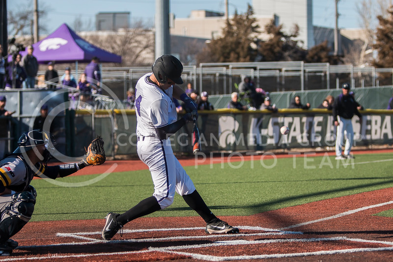 Junior infielder, Rainer Ausmus, swings at a pitch as he bats against La Salle in Tointon Family Stadium on Mar. 2, 2018. The Wildcats defeated the Explorers 9-3. (Logan Wassall | Collegian Media Group)