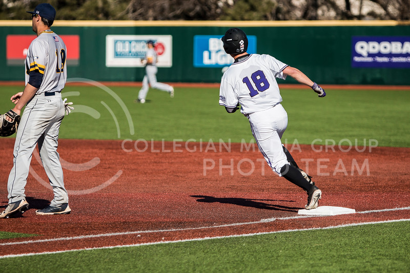 Sophomore outfielder, Will Brennan, rounds first base during the baseball game against La Salle in Tointon Family Stadium on Mar. 2, 2018. The Wildcats defeated the Explorers 9-3. (Logan Wassall | Collegian Media Group)
