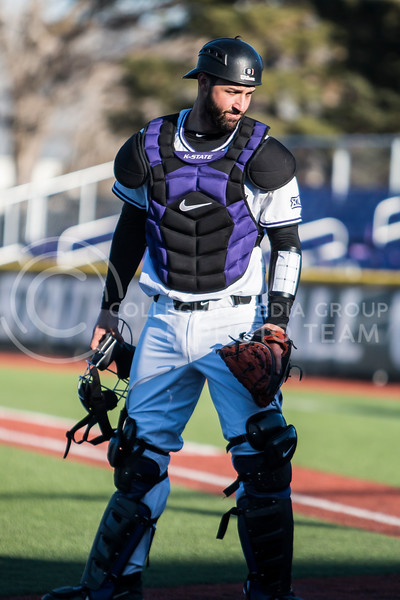 Junior catcher, TK McWhertor, plays catcher during the baseball game against La Salle in Tointon Family Stadium on Mar. 2, 2018. The Wildcats defeated the Explorers 9-3. (Logan Wassall | Collegian Media Group)