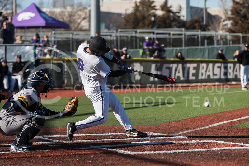 Junior catcher, TK McWhertor, swings at a pitch while at bat during the baseball game against La Salle in Tointon Family Stadium on Mar. 2, 2018. The Wildcats defeated the Explorers 9-3. (Logan Wassall | Collegian Media Group)