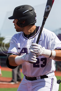 Senior first baseman, Jake Scudder, warms up in the batters box during the K-State game against New Mexico at Tointon Stadium on Apr. 18 2017. (Sabrina Cline | The Collegian)