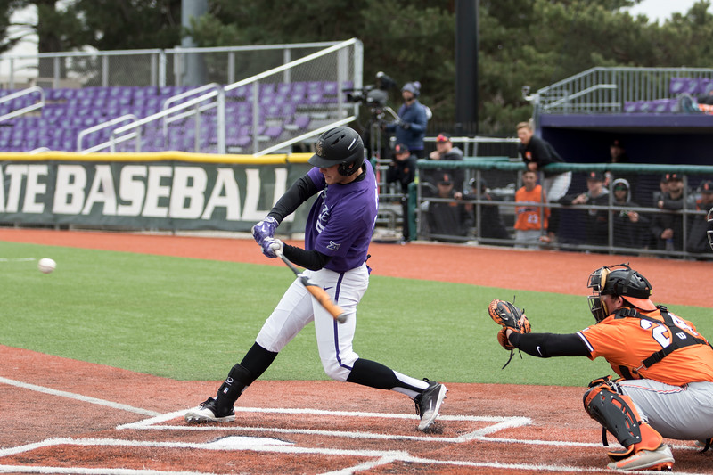 Senior outfielder Hanz Harker hits the ball during the game against Oklahoma State at Tointon Family Stadium on Apr. 9 2018. ( Sabrina Cline | Collegian Media Group )
