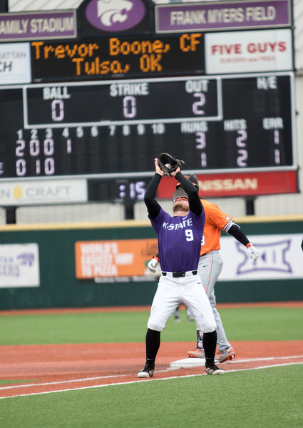 Senior infielder Trent McMaster catches a fly ball for an out during the game against Oklahoma State at Tointon Family Stadium on Apr. 9 2018. ( Sabrina Cline | Collegian Media Group )