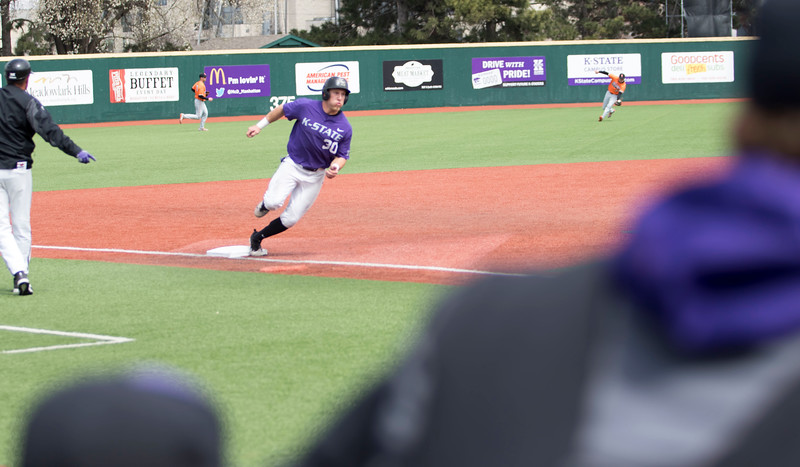 Junior infielder Drew Mount rounds third base for home during the game against Oklahoma State at Tointon Family Stadium on Apr. 9 2018. ( Sabrina Cline | Collegian Media Group )