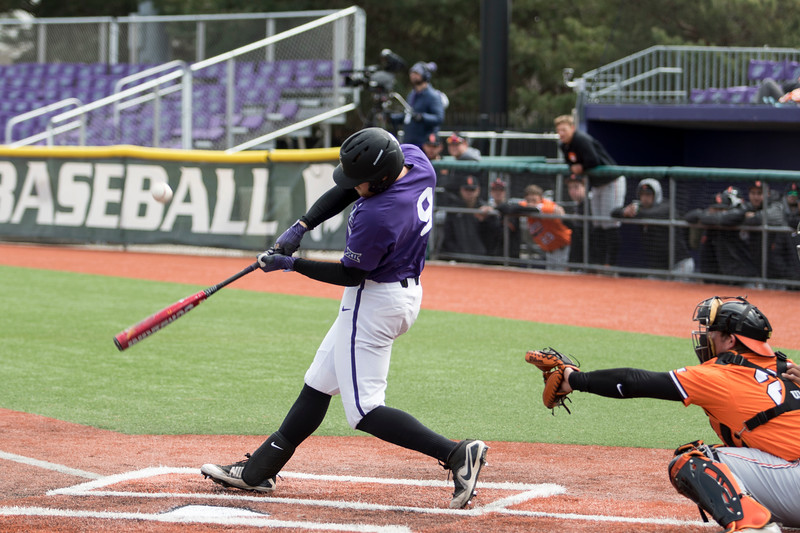 Senior infielder Trent McMaster takes a swing during the game against Oklahoma State at Tointon Family Stadium on Apr. 9 2018. ( Sabrina Cline | Collegian Media Group )