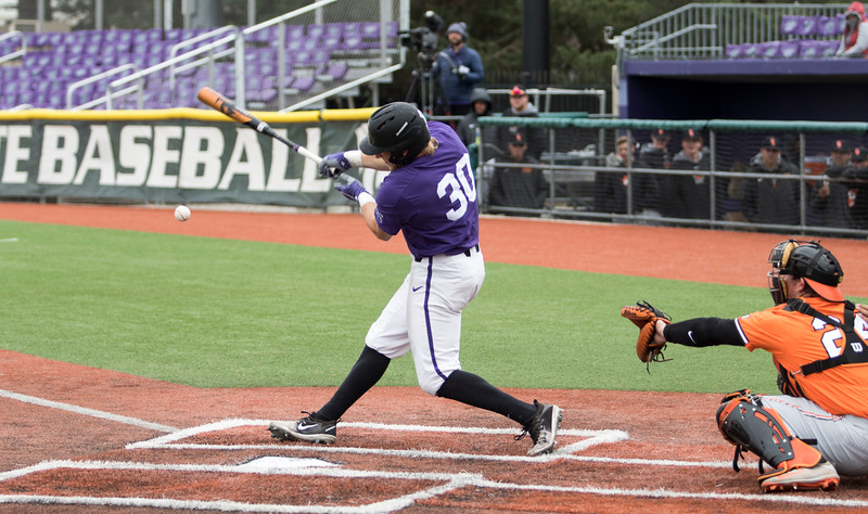Junior infielder Drew Mount hits the ball for a base hit during the game against Oklahoma State at Tointon Family Stadium on Apr. 9 2018. ( Sabrina Cline | Collegian Media Group )