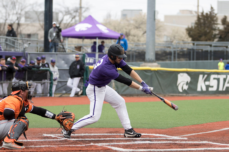 Senior outfielder Kyle Barfield puts the ball in play during the game against Oklahoma State at Tointon Family Stadium on Apr. 9 2018. ( Sabrina Cline | Collegian Media Group )