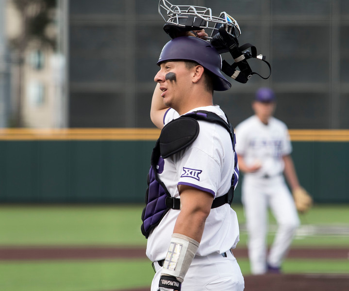 Junior catcher, Chris Ceballos looks to his coaches for the next play during the game against Oklahoma on April 26, 2019. ( Sabrina Cline | Collegian Media Group )