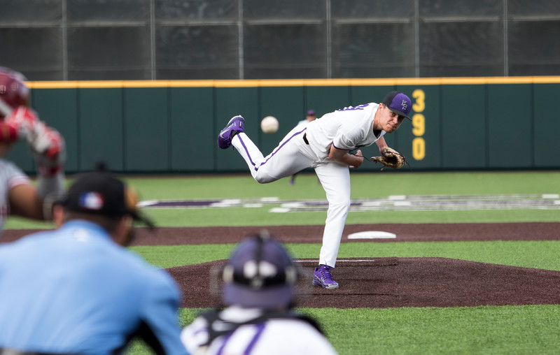 Freshman right hand pitcher, Griffin Hassall starts the game off with a pitch to the opposing Oklahoma batter at Tointon Family Stadium on April 26, 2019. ( Sabrina Cline | Collegian Media Group )