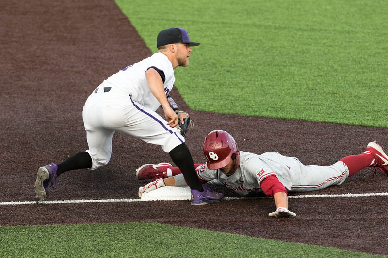 Junior third baseman Cameron Thompson attempts to tag the runner out at third base after the throw in from the outfield during the game against Oklahoma on April 26, 2019. ( Sabrina Cline | Collegian Media Group )