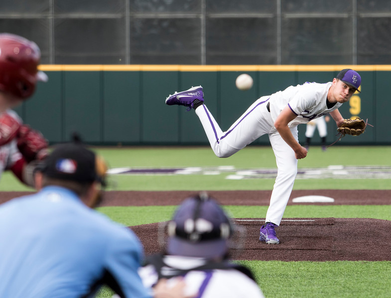 Freshman right hand pitcher Griffin Hassall delivers the pitch during the game against Oklahoma on April 26, 2019. ( Sabrina Cline | Collegian Media Group )