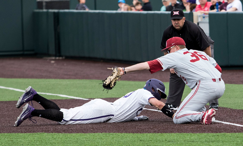 Junior outfielder Will Brennan beats out the throw to make it safe back to first base during the game against Oklahoma on April 26, 2019. ( Sabrina Cline | Collegian Media Group )