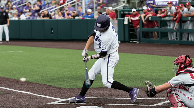 Junior infielder Cameron Thompson hits a ground ball during the game against Oklahoma on April 26, 2019. ( Sabrina Cline | Collegian Media Group )