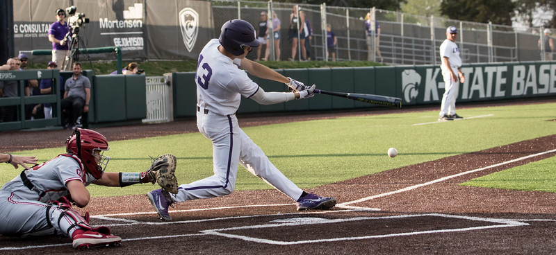Junior designated hitter Caleb Littlejim makes contact with the ball during the game against Oklahoma on April 26, 2019. ( Sabrina Cline | Collegian Media Group )