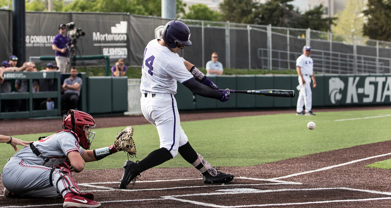 Senior infielder Rainer Ausmus makes contact with the ball during the game against Oklahoma on April 26, 2019. ( Sabrina Cline | Collegian Media Group )