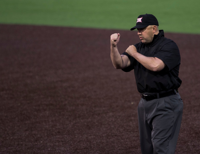 An umpire makes the call at first base, calling the runner out during the game against Oklahoma on April 26, 2019. ( Sabrina Cline | Collegian Media Group )