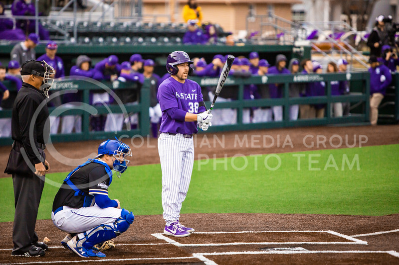 Junior catcher Austin Garrett swings at a pitch during K-State's baseball game against South Dakota State in Tointon Family Stadium on March 10, 2020. The Jackrabbits beat the Wildcats 4-0. (Logan Wassall | Collegian Media Group)