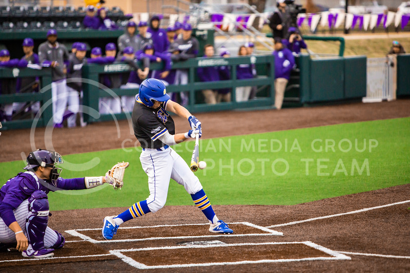A South Dakota State player swings at a pitch during their baseball game against K-State in Tointon Family Stadium on March 10, 2020. The Jackrabbits beat the Wildcats 4-0. (Logan Wassall | Collegian Media Group)