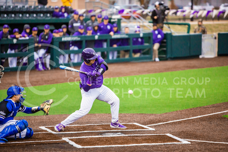 K-State's designated hitter swings at a pitch during K-State's baseball game against South Dakota State in Tointon Family Stadium on March 10, 2020. The Jackrabbits beat the Wildcats 4-0. (Logan Wassall | Collegian Media Group)