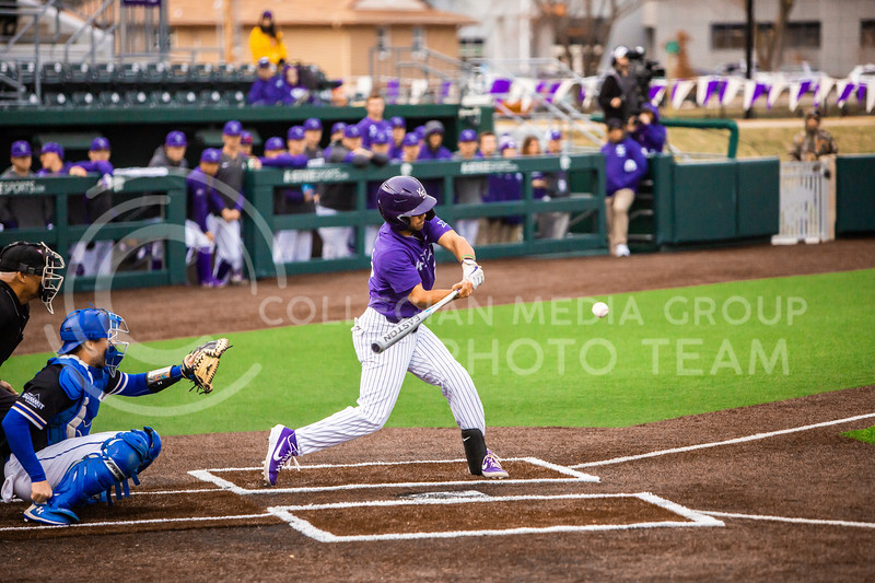 Sophomore infielder Daniel Carinci swings at a pitch during K-State's baseball game against South Dakota State in Tointon Family Stadium on March 10, 2020. The Jackrabbits beat the Wildcats 4-0. (Logan Wassall | Collegian Media Group)