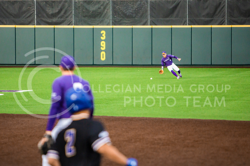 Sophomore center fielder Blake Burrows fields the ball during K-State's baseball game against South Dakota State in Tointon Family Stadium on March 10, 2020. The Jackrabbits beat the Wildcats 4-0. (Logan Wassall | Collegian Media Group)