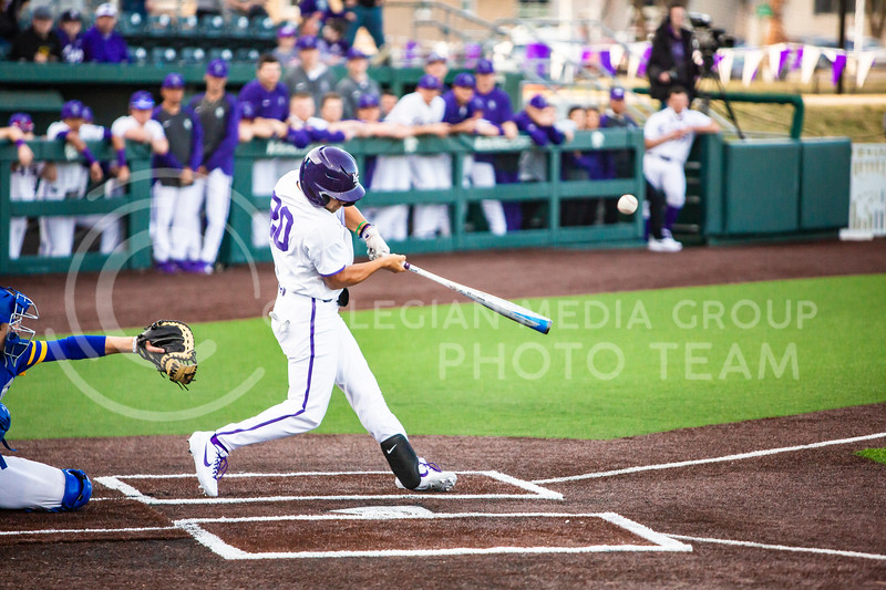 Sophomore infielder Daniel Carinci swings at a pitch during K-State's baseball game against South Dakota State in Tointon Family Stadium on March 11, 2020. The Wildcats beat the Jackrabbits 10-0. (Logan Wassall | Collegian Media Group)