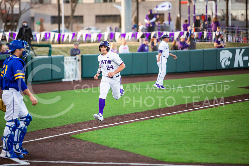 Sophomore pitcher Dylan Phillips runs towards home plate during K-State's baseball game against South Dakota State in Tointon Family Stadium on March 11, 2020. The Wildcats beat the Jackrabbits 10-0. (Logan Wassall | Collegian Media Group)