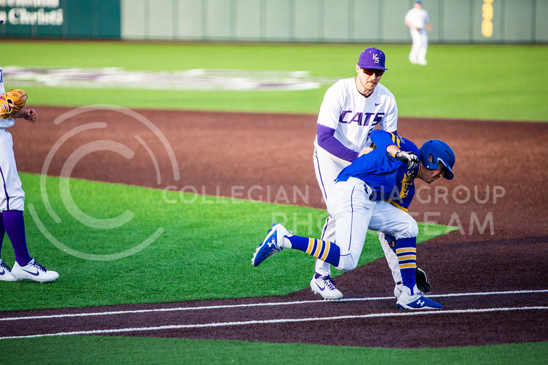 Junior first baseman tags a South Dakota State player during K-State's baseball game against them in Tointon Family Stadium on March 11, 2020. The Wildcats beat the Jackrabbits 10-0. (Logan Wassall | Collegian Media Group)