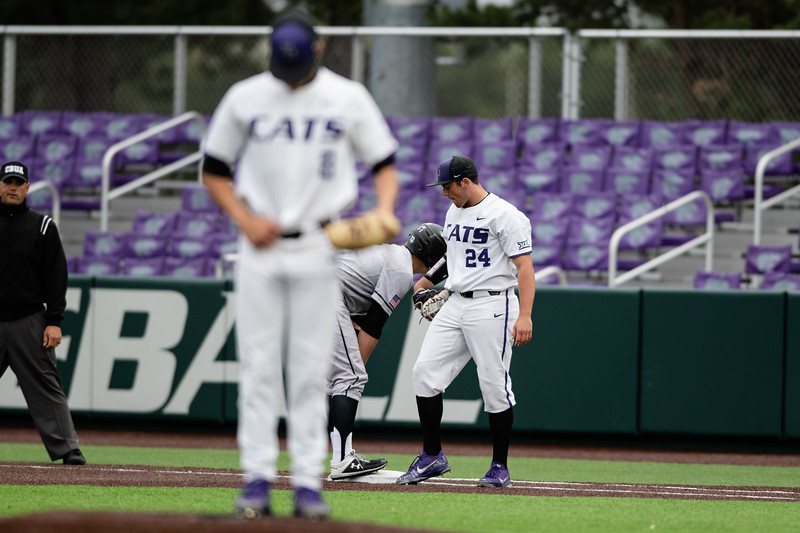 Kansas State Univeristy freshman right-handed pitcher Dylan Phillips waits at first base to see if fellow player sophomore right-handed pitcher Andrew Stratman will throw the ball to get the first base runner out. The K-State Wildcats faced off against the Wichita State Shockers winning the single game series 7-2. (Olivia Bergmeier | Collegian Media Group)