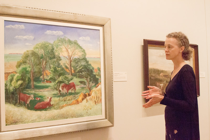 Elizabeth Seaton, one of the curators at the Marianna Kistler Beach Museum of Art, talks about of her favorite pieces in the gallery, Kansas Pasture a painting by John Steuart Curry, on Sept. 11th, 2019. (Sarah Millard | Collegian Media Group)