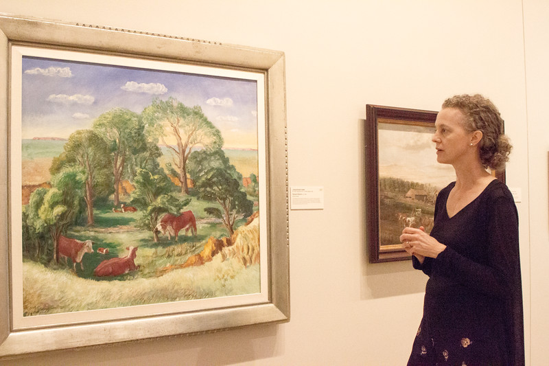 Elizabeth Seaton, one of the curators at the Marianna Kistler Beach Museum of Art, talks about one of her favorite pieces in the gallery, Kansas Pasture a painting by John Steuart Curry, on Sept. 11th, 2019. (Sarah Millard | Collegian Media Group)