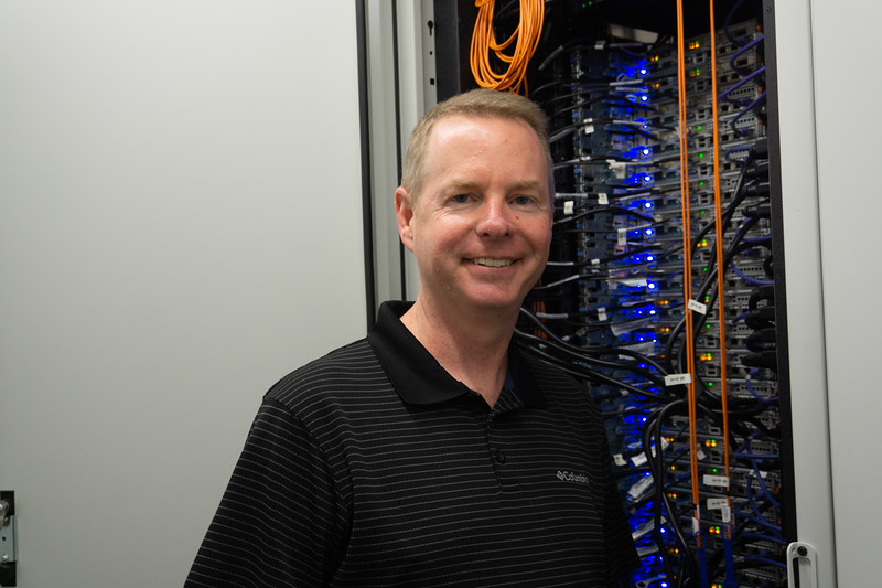 Dan Andreasen shows the many parts that go into the supercomputer BeoCat. BeoCat is housed in the Engineering Building and is used for the research of multiple departments at k-state Sept. 13, 2019. (Abigail Compton| Collegian Media Group).