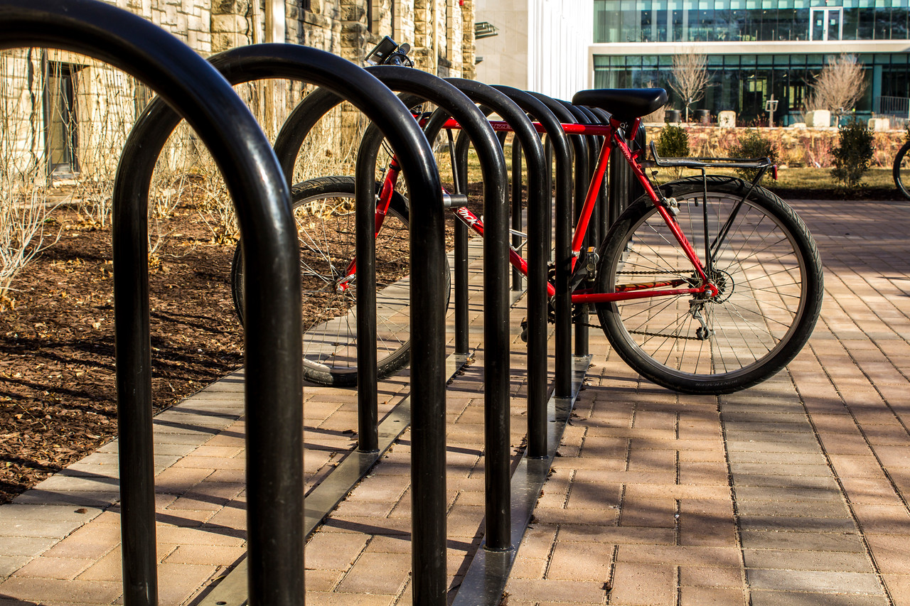 Bicycles sit in the bike racks on the campus of Kansas State University. (Andrea Klepper | Collegian Media Group)