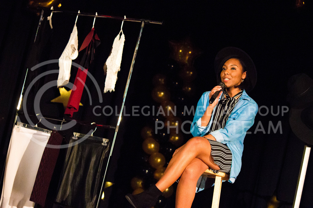 Jaliyiah Brown, senior in Apparel and Textiles, talks about African American women culture her speech about Black Girl Magic during the talent portion at the 18th Annual Black and Gold Pagent at the student union on Dec. 3.<br /> ( Alanud Alanazi | The Collegian)
