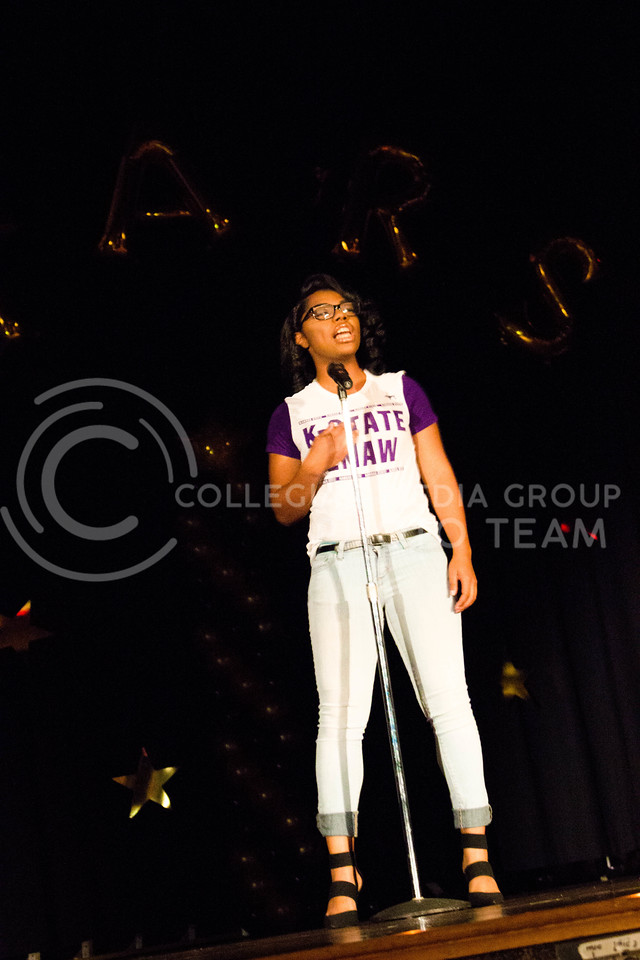 Keneysha Mckinney, freshman in Business Adminstration, recites her original poem during the talent portion at the 18th Annual Black and Gold Pagent at the student union on Dec. 3.<br /> ( Alanud Alanazi | The Collegian)