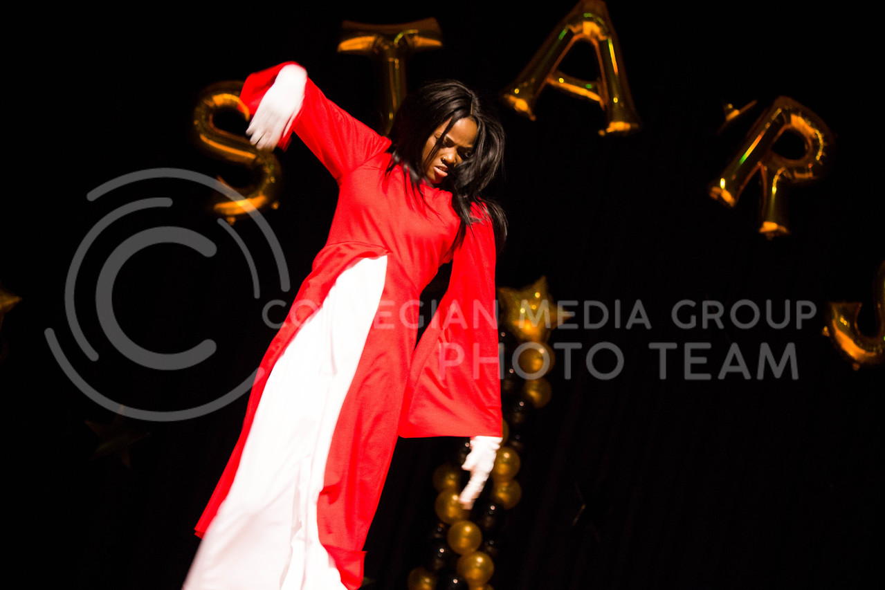 Jatashia Matlock, sophomore in Social Science, performs her interpretive dancing during the talent portion at the 18th Annual Black and Gold Pagent at the student union on Dec. 3.<br /> ( Alanud Alanazi | The Collegian)